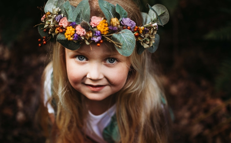 London Family Photographer, a young girl wears a crown of flowers in her blonde hair