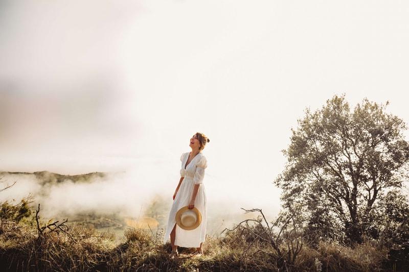 London Family Photographer, Aida Llanos standing in a foggy field